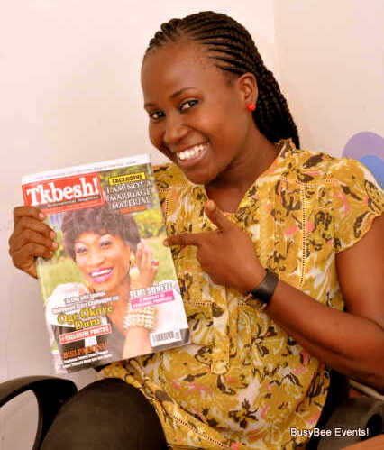 Bisi with a copy of Tkbesh!