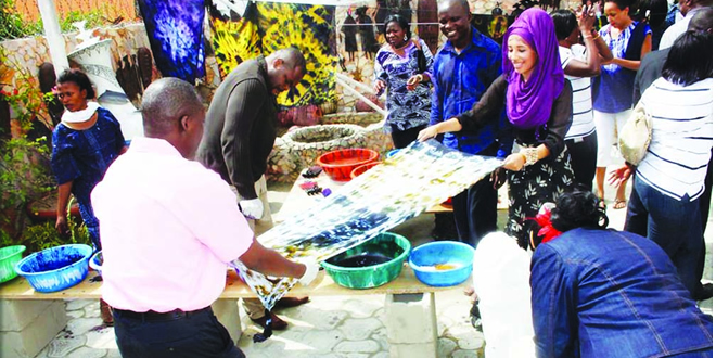 All-hands-on-deck.-People-dyeing-fabrics-at-Nike-Art-Centre-Lagos.jpg