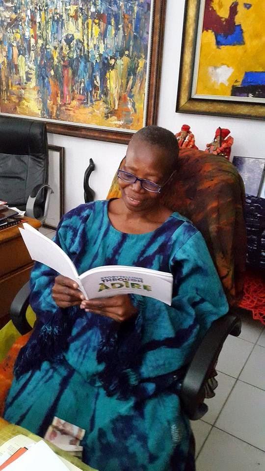 CEO of Nike Art Centre, Okundaye,  enjoying their new book 'Storytelling Through Adire